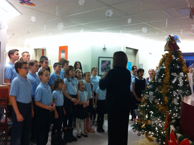 Choir School children sing at a local hospice, December 2013