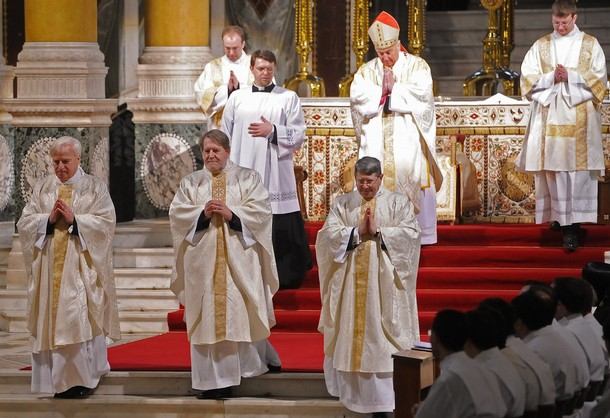 Three former Anglican Bishops (From L) Reverend John Broadhurst, Reverend Andrew Burnham and Reverend Keith Newton are pictured during a service at Westminster Cathedral on January 15, 2011 in London. The former Anglican bishops are opposed to the introduction of women bishops in the Church of England. Their ordination marks the inauguration of a special section of the Catholic Church for Anglicans known as the Ordinariate. The Vatican will allow them to maintain a distinct religious identity and spiritual heritage within the Roman Catholic Ordinariate. AFP PHOTO/Carl de Souza (Photo credit should read CARL DE SOUZA/AFP/Getty Images)